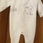 Personalised velour baby playsuit